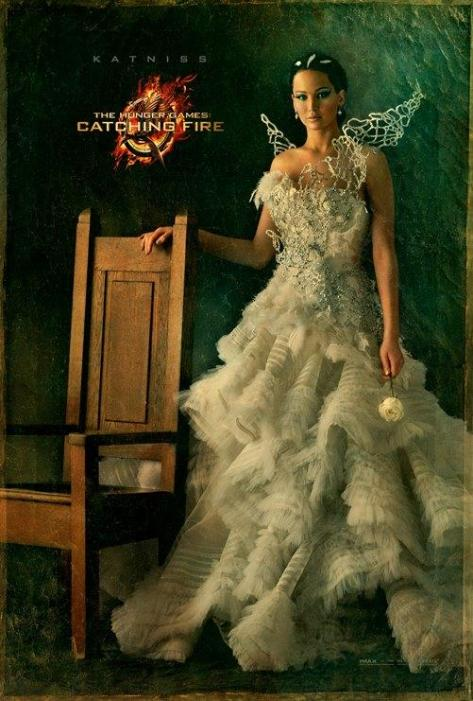 Jennifer Lawrence, the girl on fire, dazzles in white